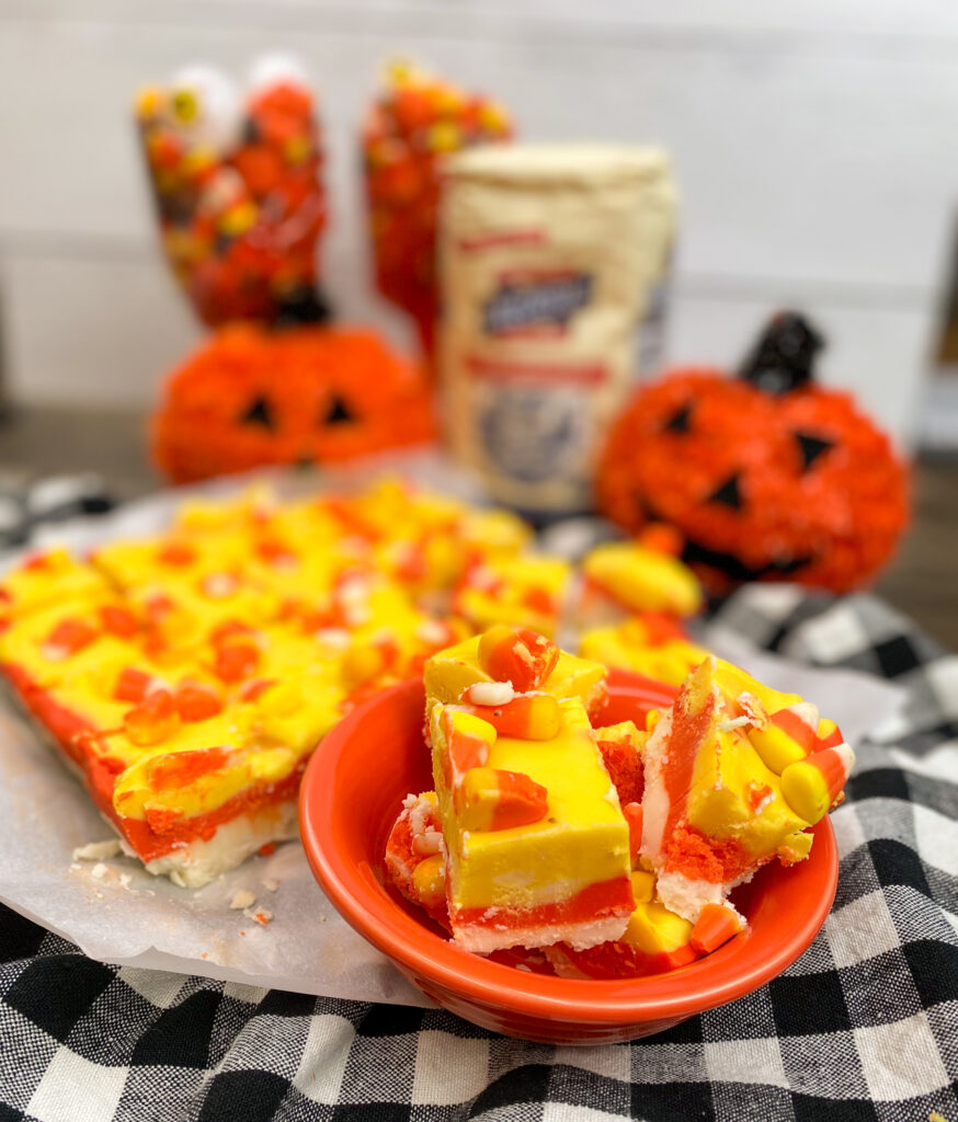 Candy corn fudge in a bowl and on the counter.
