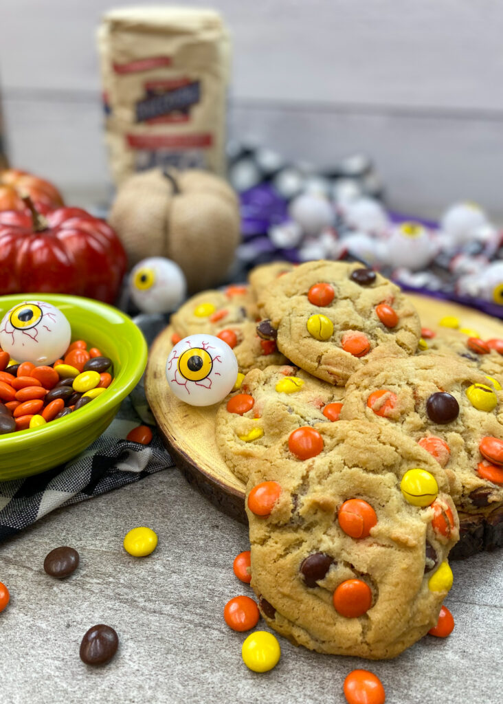 Halloween cookies on the counter with Reese's pieces