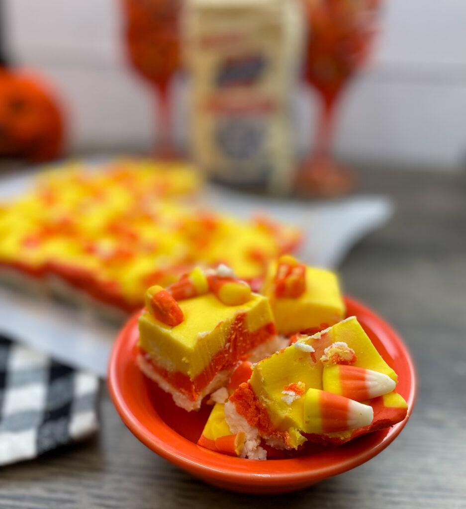 Candy corn fudge in an orange dish.